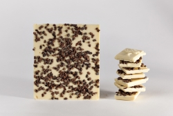 White chocolate bar with cocoa nibs